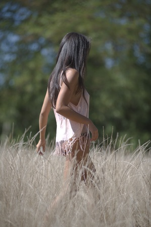 Young Mediterranean woman freely through the meadows photo