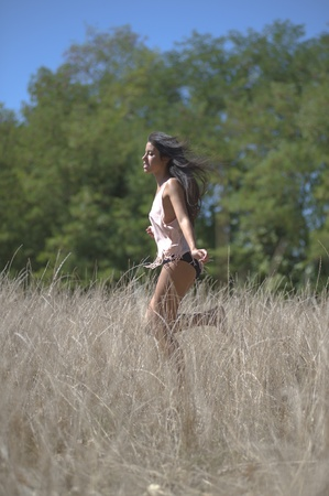 Young Mediterranean woman freely through the meadows