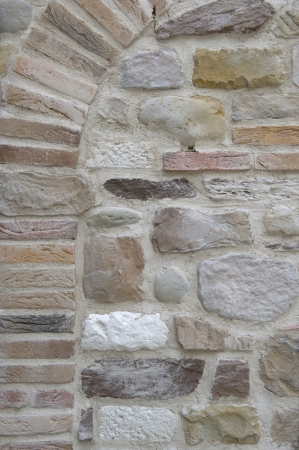 Old stone wall, the wall of an old house in the countryside