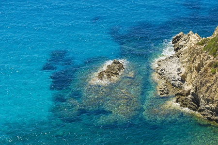 Panorama seen from the sea, clear water and rocks-stone  Mediterranean Sea, Sardinia, Italy
