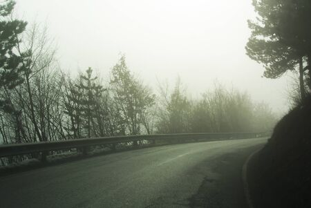 Mountain road on a foggy day Stock Photo