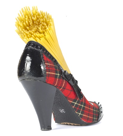 Portion of uncooked spaghetti in the Scottish heeled shoe