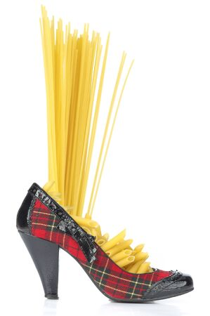 Pasta - spaghetti and penne in the shoe Scottish Imagens