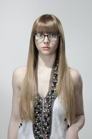 Girl with long hair, red lips and glasses Imagens