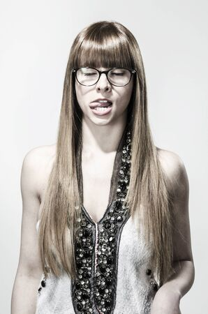 Grimaces - Girl with tongue out Imagens