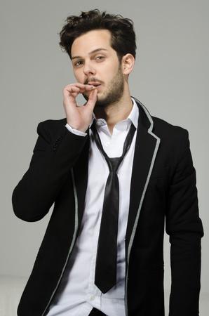 Waist of a boy - man smoking