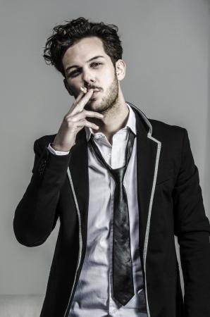 man smoking: Waist of a boy - man smoking