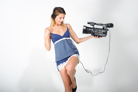 Girl with headphones and camera Imagens