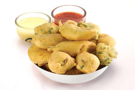 Indian Street Fried Food Pakora Also Know as Pakoda, Bhajiya, Bhajia, Methi Gota, Kanda Bhaji, Pyaz Pakoda, Fried Chillies, Onion Wada, potato vada, aloo Bhajji or fritter, Served with Chutney.
