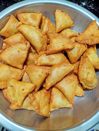 Samosa or samosas (samsa) street food, punjabi samosa or Coxinha, Croquete and other Fried Brazilian Snacks. - Image