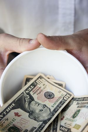 A man using a begging bowl to help him get on with life.