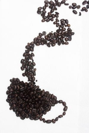 A cup of coffee, made from the coffee bean.  This is a graphical representation of coffee and the pleasure it brings people Stock Photo - 4015211