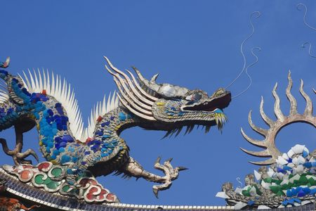 Chinese dragons on a temple roof.  Dragons have a special place in Chinese mythology.  Traditional they were thought to control to the weather and water related things. Stock Photo - 4015215