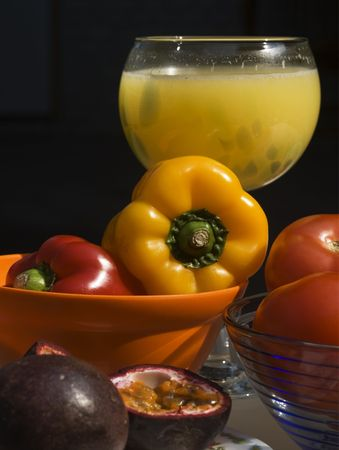 Colourful peppers, red tomatoes, orange juice and passion fruit. These are colourful foods that are great for your health. They contain loads of vitamins and antioxidants. Stock Photo - 4015210