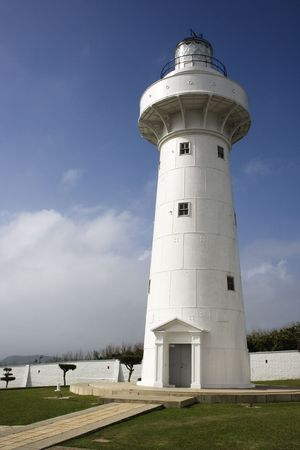 This is Eluanbi Lighthouse at the southern tip of Taiwan.  Its white and helps ships get around the south coast of Taiwan