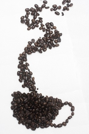 A cup of coffee, made from the coffee bean.  This is a graphical representation of coffee and the pleasure it brings people