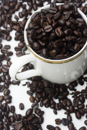 graphical: A cup of coffee, made from the coffee bean.  This is a graphical representation of coffee and the pleasure it brings people