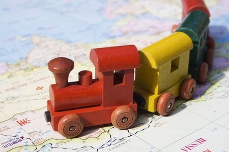 Travel Asia and Russia.  A map of Asia and a toy train.  This is the dream of international travel and adventure.  Also refers to the transsiberian train journey.  The classic train journey from Moscow to Beijing. Stock Photo