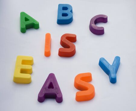Children's alphabet letters are used to spell 'ABC is EASY'.  This is a reference to learning made easy.  It could be learning English or any subject. Stock Photo - 4112553