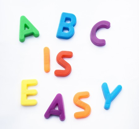 Children's alphabet letters are used to spell 'ABC is EASY'.  This is a reference to learning made easy.  It could be learning English or any subject. Stock Photo - 4112552