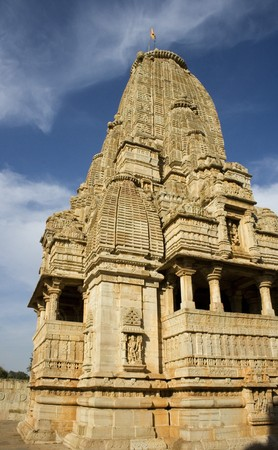 permanence: An Indian Temple at Chittor, Rajasthan.  This temple is built on a hill with many other old buildings.  Its a classic Indian shaped temple.