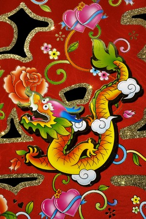 Chinese decoration for Chinese New Year.  This is a dragon motif on decoration used for Chinese New Year, also known as Spring Festival.  With black background.