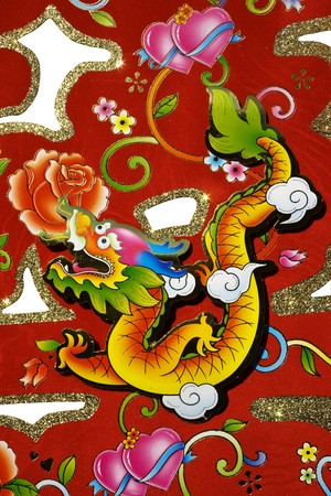 vicious: Chinese decoration for Chinese New Year.  This is a dragon motif on decoration used for Chinese New Year, also known as Spring Festival.  With white background. Stock Photo