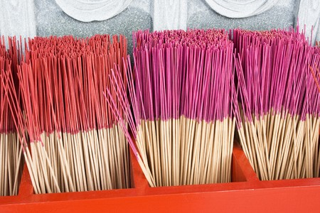 Joss sticks in a red box at a Chinese temple.  they are tradional burnt before an image or icon in Asian culture, Stock Photo - 4150944
