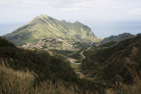 Keelung Mountain and village, on the north east coast of Taiwan.  This area used to be a mining, where gold and coal was mined. The area has spectacular scenery. Stock Photo