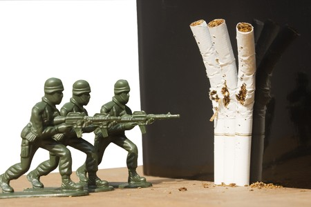 Give it up!  Three soldiers act as a firing squad.  They are shooting three cigarettes.  It's a metaphor for quitting smoking.  It could always be used for a no smoking sign.
