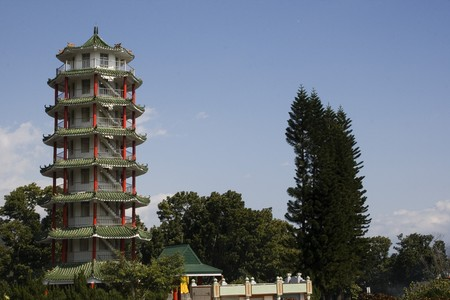 A tall pagoda in the countryside.  Pagodas are in general religious buildings.  They are tall and have many layers. Stock Photo - 4301324