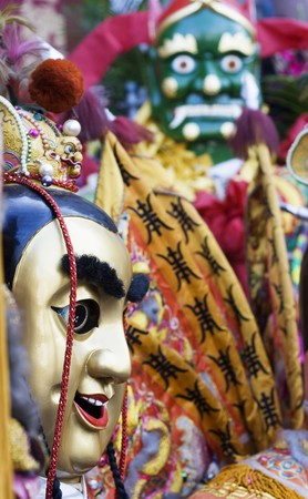 These are man-size puppets or costumes worn by temple workers during parades.  They are popular in Taiwan and are paraded on a regular bases.  They form a core part of Chinese Culture.  The green-face god has very good hearing and saves seafarers