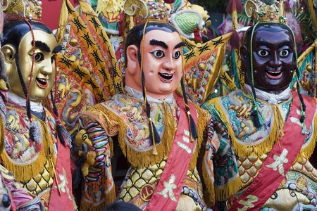 These are man-size puppets or costumes worn by temple workers during parades.  They are popular in Taiwan and are paraded on a regular bases.  They form a core part of Chinese Culture.