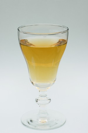 syrupy: This is a glass of Japanese wine, usually served as an aperitif.  Its a sweet, syrupy wine that comes with plums in the bottle.
