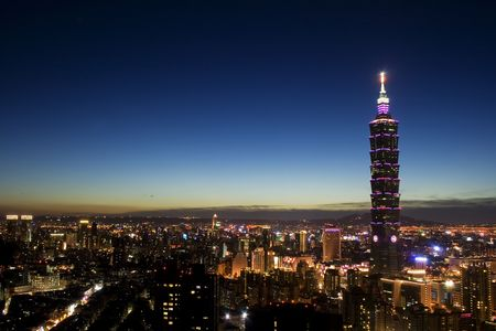 This is a view of Taipei City just after sunset.  The tall building is Taipei 101 and the closest area is Taipei commerical district.