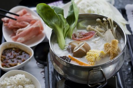 A creamy hotpot with lots of delicious vegetables in it.  Hotpot is a classic Chinese dish that's especially popular in the winter time  Standard-Bild