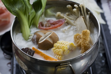 A creamy hotpot with lots of delicious vegetables in it.  Hotpot is a classic Chinese dish thats especially popular in the winter time