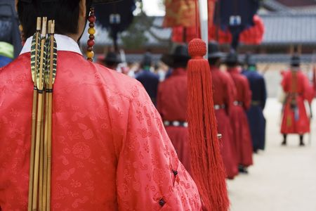 Parade at a Korean Palace for tourist.  Actors are dressed up in traditional costume to show how the emperor of Korea mightve lived. Stock Photo