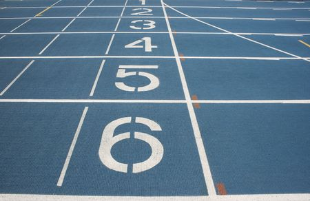 5 6: Starting Line of a blue race track.  The numbers countdown from six to one.