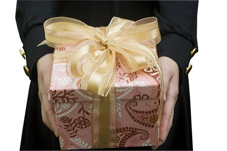 A present, is being given by a young lady.  It could be a birthday, Christmas, Wedding, gift etc. photo