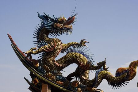 A traditional dragon sculpture with lots of movement.  This is on top of a temple. Stock Photo - 8832362