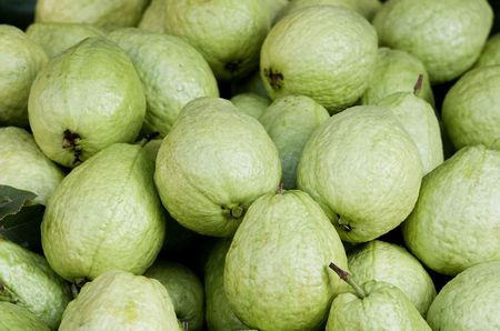 Guavas on a market stall in Asia.