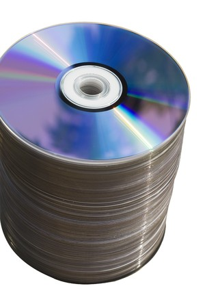 dvds: This is a stack of CDsDVDs.  Theres about 100 of them in the stack. DVDs are used to record information.  They have been isolated from their background.