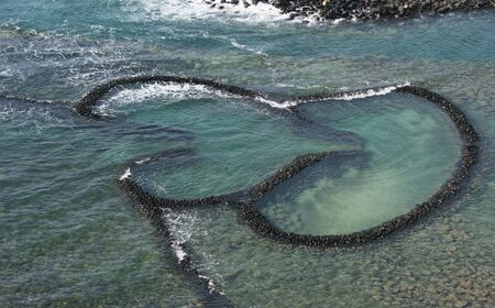 This is a double hearted fishing weir.  It's from Penghu, Islands that are off the coast of Taiwan.  This fishing method uses the tide to catch fish.