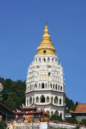 A pagoda covered in buddha images at the Kek Lok Si temple in Penang.