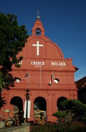 This is the red colored Christ Church in Melaka, Malaysia.  It was built by the Dutch and is a landmark building.  It also helped get Melaka UNESCO status.