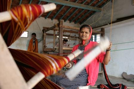 gujarat: 7th Dec 2007, near Bhuj, Gujarat, India.  A woman working on a loom.   Editorial