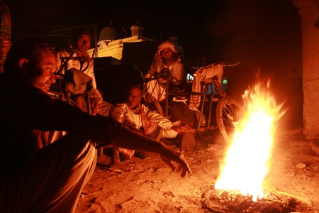 14th Dec 2007, Bhuj, India, homeless people gather around a fire on a cold winter night in India. Stock Photo - 10008806