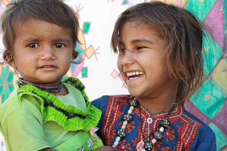 Rann of Kutch, Gujarat, India, Dec, 26, 2007; Two young tribal girls laughing Stock Photo - 11045118