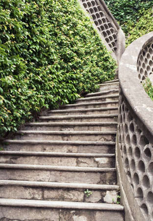 bannister: antique stone staircase in a garden